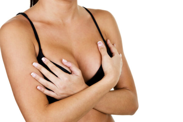 woman worried about her double bubble breast implant deformity