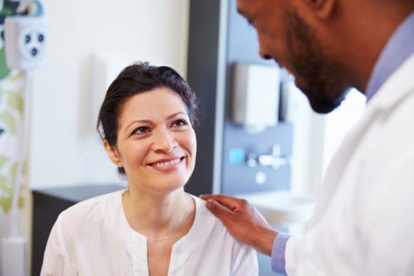 female patient in consultation plastic surgeon