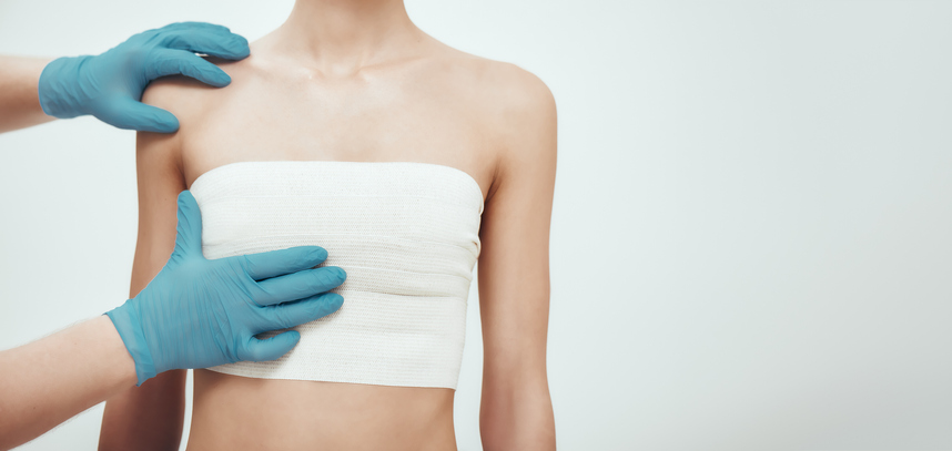 surgeon gloves with woman after breast lift