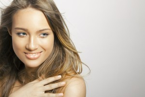 Beautiful young woman with clean fresh skin. Close up portrait, studio shot. Horizontal. copy space for your text