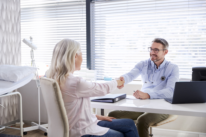 male plastic surgeon consultation with older woman