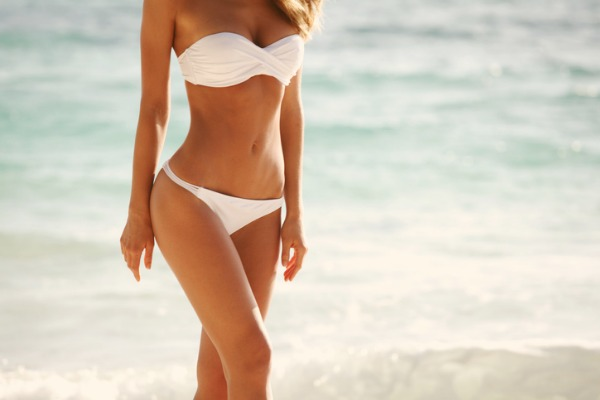 breast enlargement and implants woman on beach