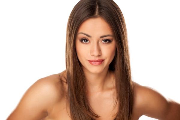 woman raising eyebrow for browpexy treatment