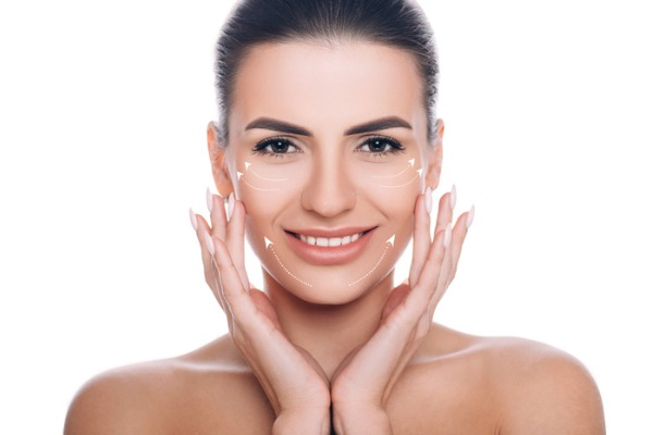 smiling woman with facelift lines on face