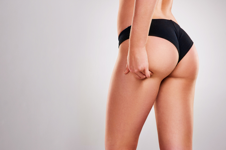 woman feeling buttock after banana roll fat treatment
