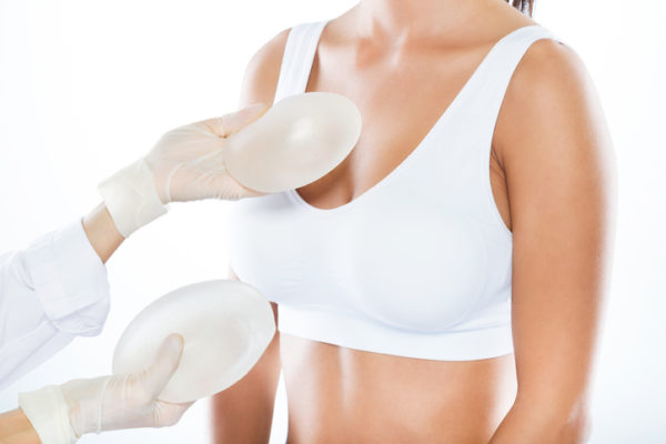 doctor showing breast implants to patient
