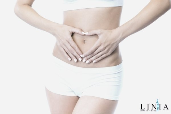 how much does a tummy tuck cost featured image of woman